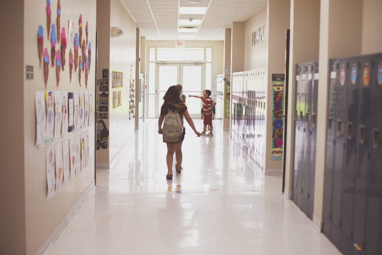 Children walking the halls of an elementary school pre Covid